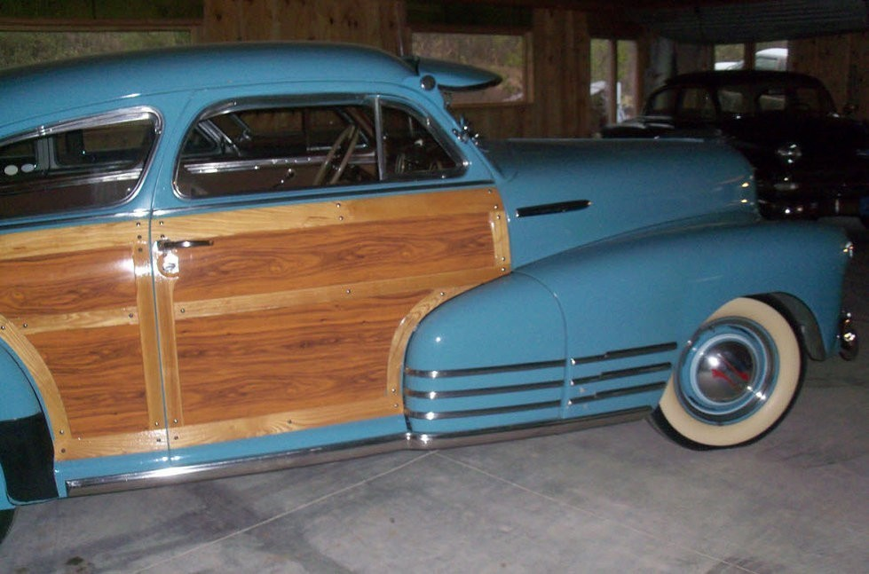 Electric blue colored 1947 Chevrolet with wooden door
