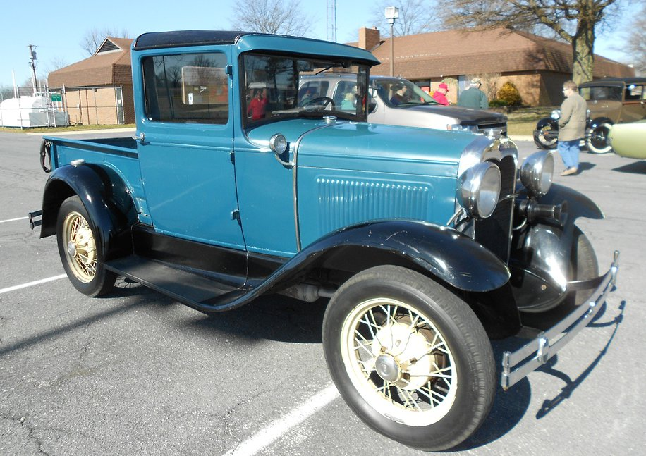Blue 1930 Ford Pick-Up in parking lot