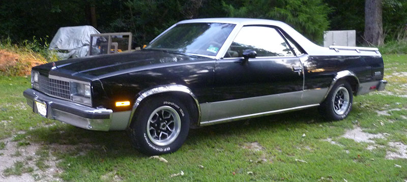 Black El Camino on grass